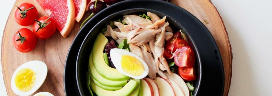 bowl of vegetable salad and fruits